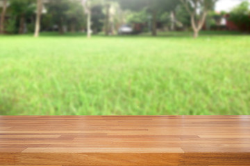 Empty wooden table and blurred green leaves  background, product display, Ready for product montage. nature garden scene