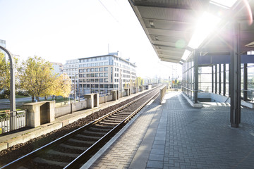 Foto auf Leinwand Bahnhof beautiful modern empty train station in the sun light of sunset