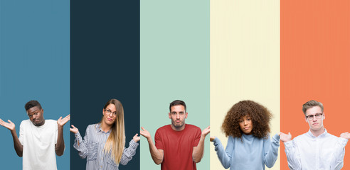 Group of people over vintage colors background clueless and confused expression with arms and hands raised. Doubt concept.