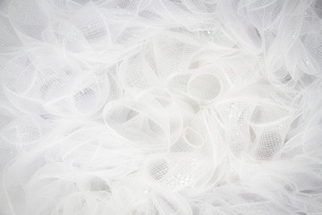 Pure white tulle fabric in an intricate frill that can be used as the background for bridal showers or baby invitations.