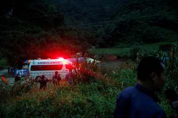 An ambulance leaves from Tham Luang cave complex in the northern province of Chiang Rai