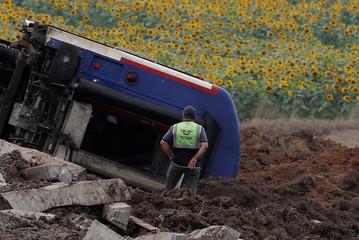A railway worker stands at the scene where a passenger train derailed on Sunday, near Corlu in Tekirdag province