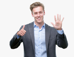 Young handsome blond business man showing and pointing up with fingers number six while smiling confident and happy.