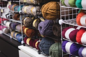 Multicolored ball of yarn kept on shelf