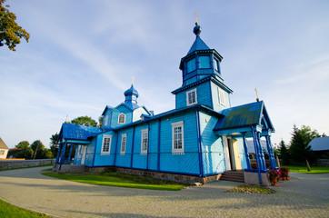 Blue wooden church in Narew, Poland