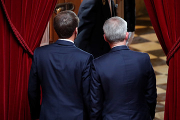 French National Assembly speaker Francois de Rugy accompanies French President Emmanuel Macron after his speech during a special congress gathering both the upper and lower houses of the French parliament in Versailles near Paris
