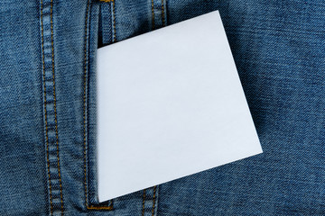 Blue jeans with white paper.