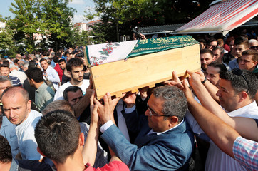 People carry coffin of Beren Kurtulus, a five-month old victim of the train accident, during her funeral ceremony in Corlu