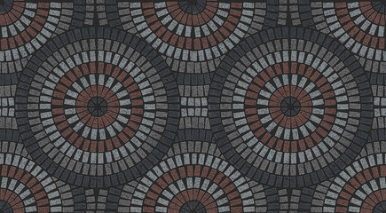 Brick laying radial patterns in patio paving