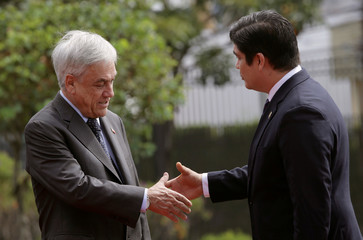 Costa Rica's President Carlos Alvarado greets Chile's Sebastian Pinera, during a welcoming ceremony at the Presidential house in San Jose, Costa Rica