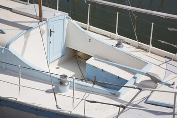 view of the deck of a white and blue sailing boat