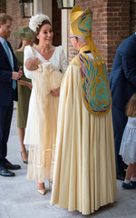 Britain's Catherine, the Duchess of Cambridge, speaks to Archbishop of Canterbury Justin Welby as she arrives carrying Prince Louis for his christening service at the Chapel Royal, St James's Palace, London