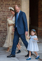Britain's Prince William and Catherine, the Duchess of Cambridge, leave the chapel with their children Prince George, Princess Charlotte and Prince Louis after Prince Louis's christening in the Chapel Royal, St James's Palace, London