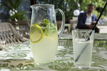 Lemonade with lemon, mint and ice.