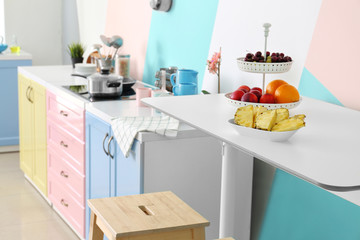 Fruits on table in modern kitchen