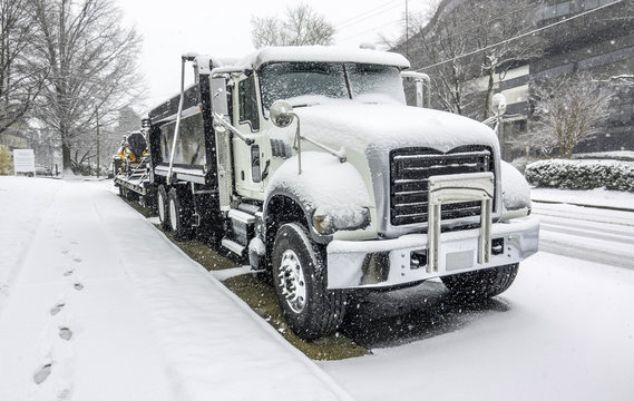 Truck Parked near curb during the blizzard (snowfalling). Snow Winter storm in Vienna, Northern Virginia (East coast) - March, 21, 2018, USA