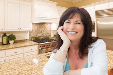 Attractive Middle Aged Woman Portrait Inside Kitchen At Home