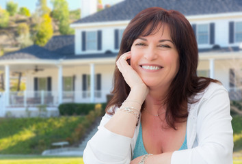 Attractive Middle Aged Woman Relaxing In Front Yard of Beautiful House