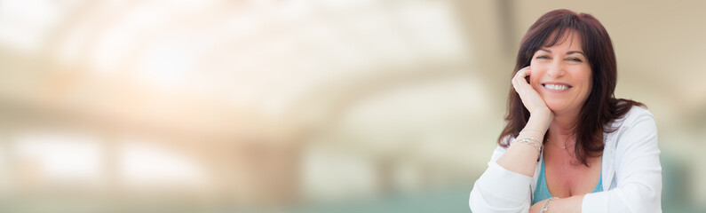 Banner of Middle Aged Woman With Abstract Building Background