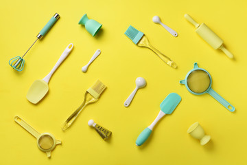 Turquoise cooking utensils on yellow background. Food ingredients. Cooking cakes and baking bread concept. Copy space. Top view. Flat lay