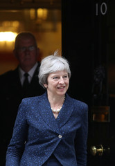 Britain's Prime Minister Theresa May emerges from 10 Downing Street in Westminster, London