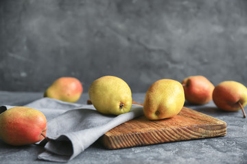 Delicious ripe pears on table