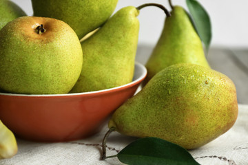 Delicious ripe pears on table, closeup