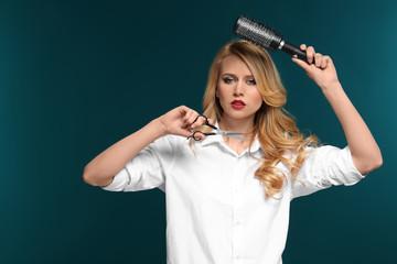 Professional hairdresser on color background