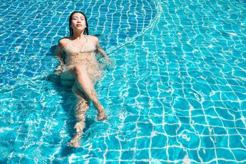 Beautiful woman bikini on swimming pool