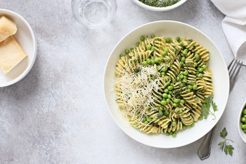 Pasta with pesto, green pea and parmesan. Overhead view, copy space