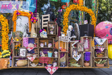 Day of the Dead offering Colorful flowers and objects honoring the departed souls