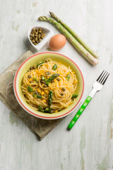 spaghetti with asparagus boiled eggs and capers