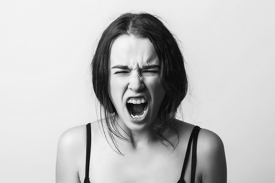 Angry screaming girl. Discontent, aggression, depression, attack, energy, cry, screaming. Black and White