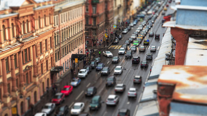 Car traffic in city St.Petersburg downtown, urban landscape with historical buildings and road, aerial view from rooftop