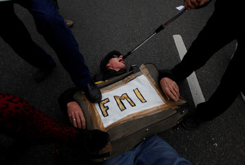 Demonstrators perform during a protest against the President Macri's government agreement with the IMF in Buenos Aires