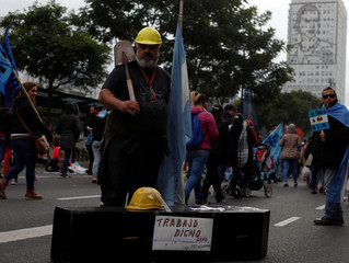 A demonstrator with a coffin and Argentine national flag attend a protest against the President Macri's government agreement with the IMF in Buenos Aires