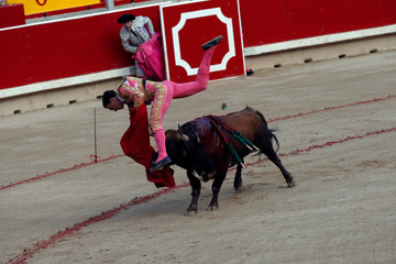 Spanish bullfighter Octavio Chacon is tossed by a bull on the fourth day of the San Fermin festival in Pamplona,