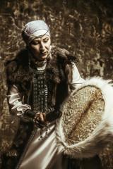 shaman beats tambourine