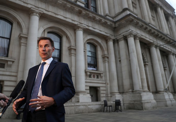 Britain's new Secretary of State for Foreign and Commonwealth Affairs Jeremy Hunt talks to the media outside the Foreign Office in central London