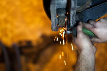 Using the cutting wheel to cut out a frozen shock bushing