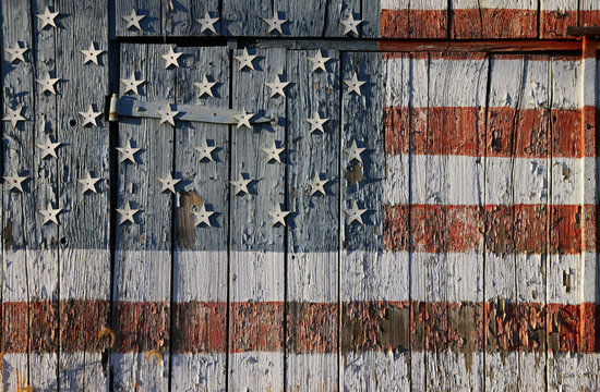 detail of old Southern Maryland tobacco barn dedicated to US Troops by painting an American Flag on barn with cut out stars attached