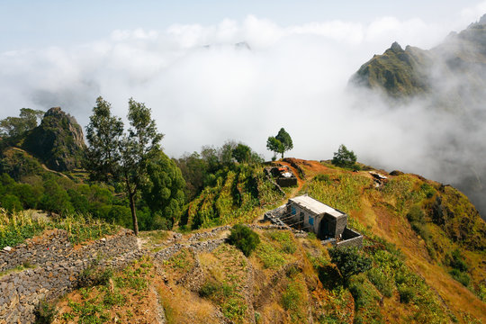 Santo Antao landscape mountains in clouds. Village house and farmlands.Cape Verde