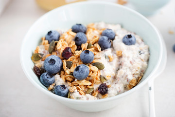 Oats with granola, dried cranberries, pumpkin seeds and blueberries