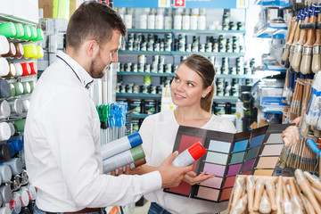 couple choosing color for painting