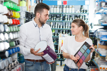 Adult man and woman  using palette scheme