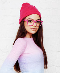 pretty young teenage girl hipster in pink glasses and hat emotional posing happy smiling, lifestyle people concept