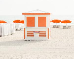 White and Orange Beach Stand on a Sunny Beach