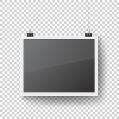 Realistic blank photo frame hanging on binder clips. Mockup picture frame isolated on transparent background. Black empty place for your text or photo. Interior decoration vector illustration.