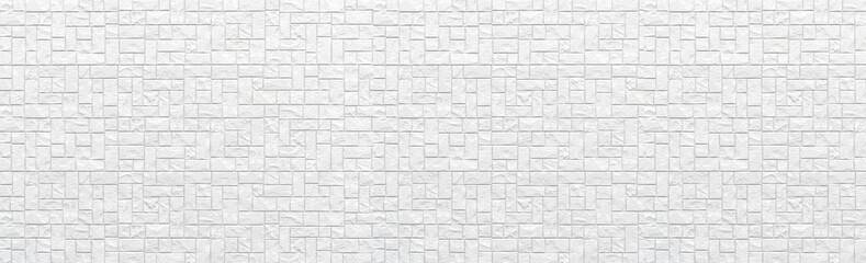 Panorama of Modern white stone tile wall pattern and background