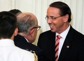 Deputy Attorney General Rosenstein talks with Giuliani after President Trump's Supreme Court nomination event at the White House in Washington
